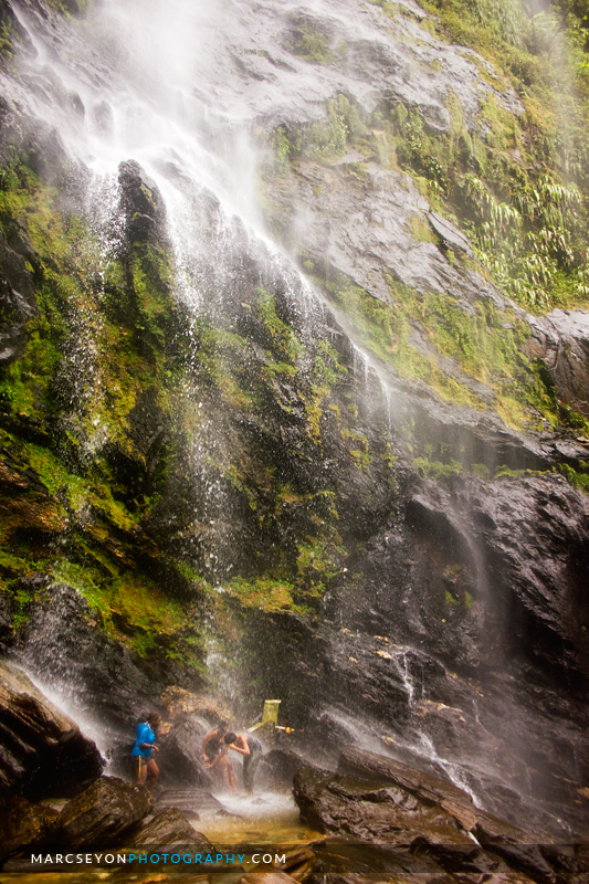Photo walkers at play under the Maracas Waterfall, Marc Seyon